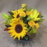 lily-and-sunflower-centerpiece-1415221448-jpg