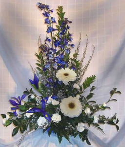 Tableside Tribute with Delphinium, Large Gerbera Daisy, Iris, Miniature Carnations and Sterling Range