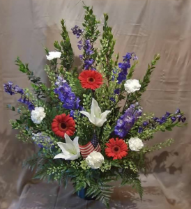 Traditional Tribute of Delphinium, Large Gerbera Daisy, Carnations, Asiatic Lilies and Penny Cress* or Monte Cassino