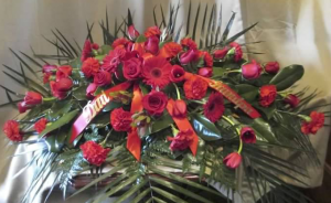 Casket Spray with Roses, Carnations, Large Gebera Daisy, and Tulips