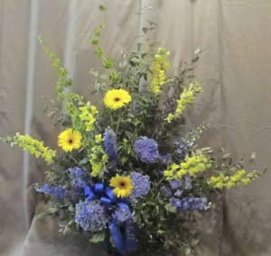 Traditional Tribute with Bells of Ireland, Delphinium, Snapdragons, Large Gerbera Dasiy and blue Hydrangeas