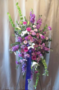 Easel Spray with Bells of Ireland, Stock, Asiatic Lilies,  Carnations, Miniature Gerbera Daisy and Alstroemeria