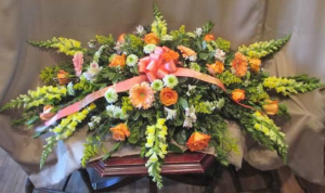 "Casket Spray with Snapdragons, Large Gerbera Daisy, Roses, Alstroemeria, ""Green Cushion"" Pom Mums, and Solidaster"