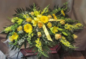 Casket Spray with Snapdragons, Bells of Ireland, Large Gerbera Daisy, Roses, Asiatic Lilies and Gypsophilia