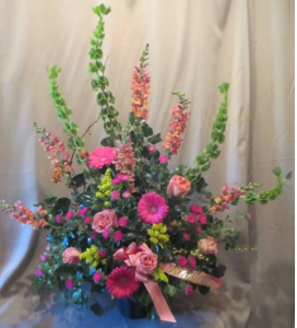 Traditional Tribute with Bells of Ireland, Snapdragons,  Large Gerbera Daisy, Roses and Asters