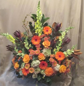 Traditional Tribute with Snapdragons, Safari Sunset, Large Gerbera Daisy, Roses, Pom Mums and Antique* Hydrangeas