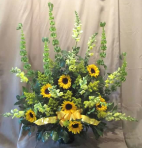 Traditional Tribute with Snapdragons, Bells of Ireland,  Sunflowers, and Solidaster