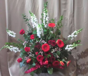 Traditional Tribute with Snapdragons, Roses,  Large Gerbera Daisy, Pom Mums, Tulips* and Waxflower