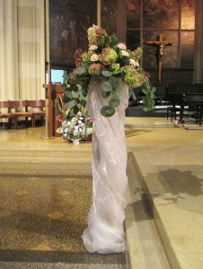 Organza wrapped column with Hydrangea, Roses, and Eucalyptus
