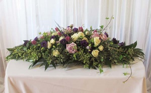 Floral Table Arrangement with Lavender and Ivory Roses, Lisianthus, Tulips, and mixed greens