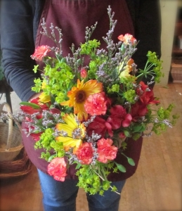 Bouquet with a mix of Gerbera Daisies, Carnations, Alstroemeria, and a variety of greens