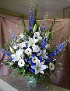 Traditional Tribute with Delphinium, Oriental Lilies, Large Gerbera Dasiy and Roses