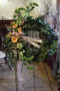 Floral Wreath with Bells of Ireland, Snapdragons, Large Gerbera, Alstroemeria and Monte Cassino with a variety of mixed greenery