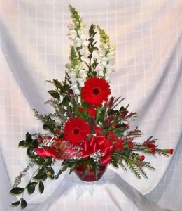 Tableside Tribute with Snapdragons,  Large Gerbera Daisy, Miniature Carnations and Sterling Range