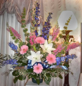 Traditional Tribute with Bells of Ireland, Delphinium, Snapdragons,  Large Gerbera Daisy, Oriental Lilies, and Limonium