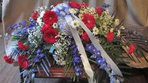 Casket Spray with Delphinium, Hydrangea, Large Gerbera Daisy, Carnations, Daisy Poms and Gypsophila