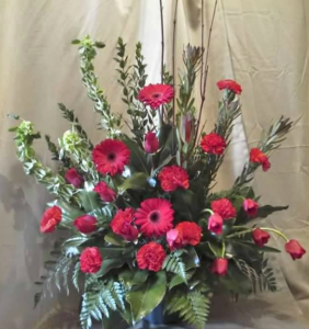 Traditional Tribute with Bells of Ireland, Safari Sunset, Roses,  Large Gerbera Daisy, Carnations and Tulips