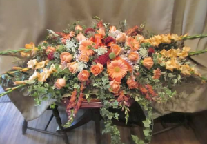 Casket Spray with Gladiolas*, Snapdragons, Large Gerbera Daisy, Roses, Cockscomb and Queen Annes Lace