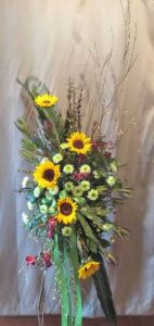 "Easel Tribute with Sunflowers, Alstroemeria, Safari Sunset, ""Green Cushion"" Pom Mums, Large Sago Palm,"