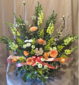 Traditional Tribute with Snapdragons, Large Gerbera Daisy, Roses, Alstroemeria, Pom Mums and Solidaster
