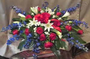 Casket Spray with Delphinium, Asiatic Lily, Large Roses, and Freesia