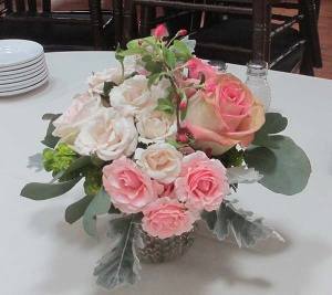 Glass vase centerpiece with Pink and Ivory Roses, Eucalyptus, and Dusty Miller