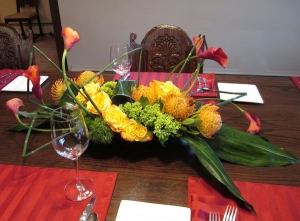 Modern Dinner Party Centerpiece with Roses, Protia, Calla Lilies, Hydrangea and greens